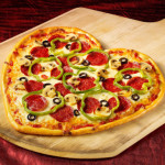 Heart-Shaped-Pizza-on-wooden-server